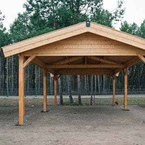 Wooden Carport in field