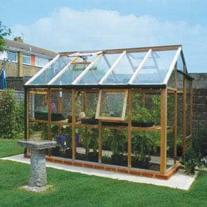 cedar greenhouse with plants growing