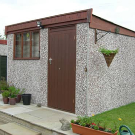 Grey Concrete Shed with Brown Doors