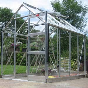 high eave greenhouse with swinging door